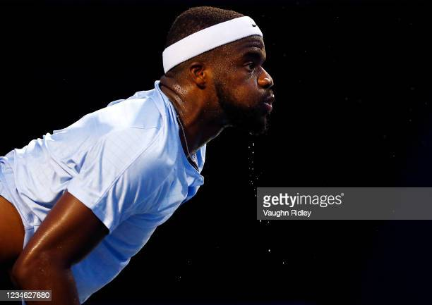 Frances Tiafoe of the United States serves against Denis Shapovalov of Canada during the second round on Day Three of the National Bank Open at Aviva...