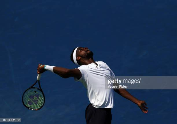 Frances Tiafoe of the United States serves against Grigor Dimitrov of Bulgaria during a 3rd round match on Day 4 of the Rogers Cup at Aviva Centre on...