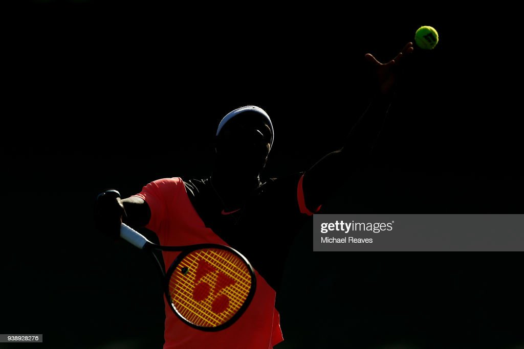 Frances Tiafoe of the United States serves against Kevin Anderson of South Africa during Day 9 of the Miami Open at the Crandon Park Tennis Center on March 27, 2018 in Key Biscayne, Florida.
