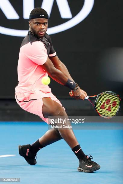Frances Tiafoe of the US hits a backhand in his first round match against Juan Martin del Potro of Argentina on day two of the 2018 Australian Open...