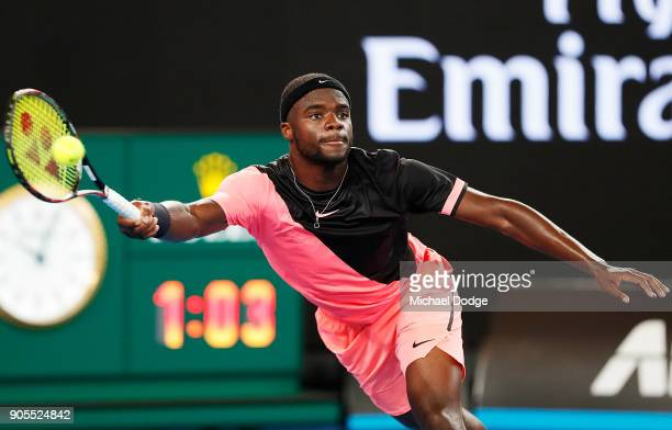 Frances Tiafoe of the US hits a forhand in his first round match against Juan Martin del Potro of Argentina on day two of the 2018 Australian Open at...