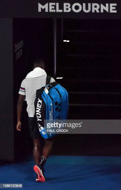 Frances Tiafoe of the US leaves the court after his defeat against Spain's Rafael Nadal during their men's singles quarterfinal match on day nine of...