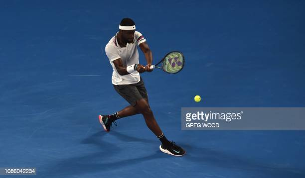 Frances Tiafoe of the US plays a backhand return to Spain's Rafael Nadal during their men's singles quarterfinal match on day nine of the Australian...
