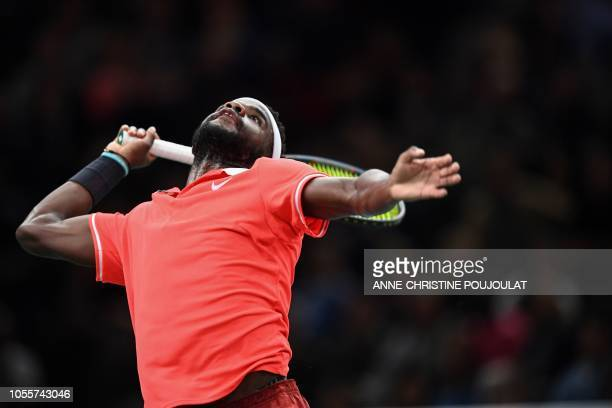 TOPSHOT Frances Tiafoe of the US serves the ball to Germany's Alexander Zverev during their men's singles second round tennis match on day three of...