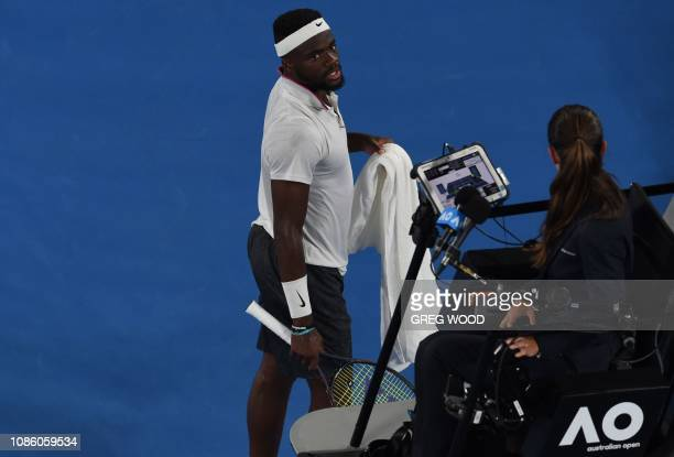 Frances Tiafoe of the US speaks to the umpire during his men's singles quarterfinal match against Spain's Rafael Nadal on day nine of the Australian...