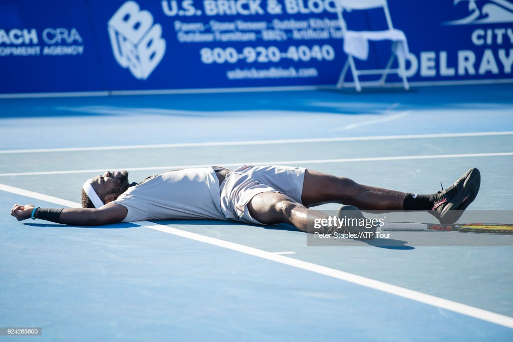 Frances Tiafoe of United States celebrates and falls to the ground on match point in his winning singles championship match against Peter Gojowczyk of Germany at the Delray Beach Open held at the Delray Beach Stadium & Tennis Center on February 25, 2018 in Delray Beach, Florida