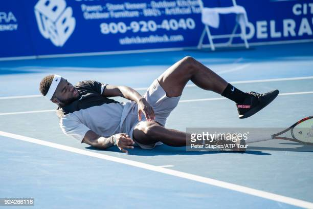 Frances Tiafoe of United States celebrates and falls to the ground on match point in his winning singles championship match against Peter Gojowczyk...