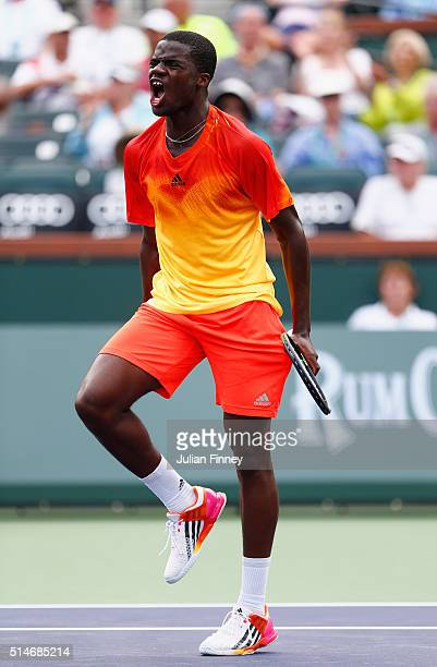 Frances Tiafoe of USA celebrates defeating Taylor Fritz of USA during day four of the BNP Paribas Open at Indian Wells Tennis Garden on March 10,...