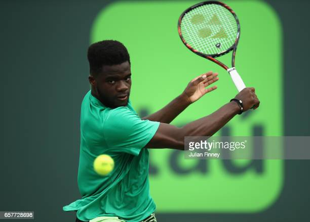 Frances Tiafoe of USA in action against Roger Federer of Switzerland at Crandon Park Tennis Center on March 25 2017 in Key Biscayne Florida