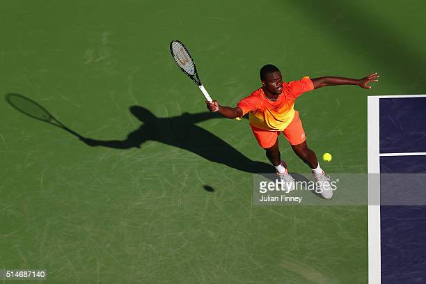 Frances Tiafoe of USA plays a forehand against Taylor Fritz of USA during day four of the BNP Paribas Open at Indian Wells Tennis Garden on March 10,...