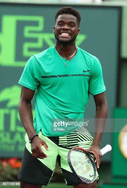 Frances Tiafoe reacts against Roger Federer of Switzerland during day 6 of the Miami Open at Crandon Park Tennis Center on March 25 2017 in Key...