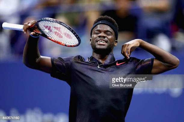 Frances Tiafoe returns plays Roger Federer of Switzerland on Day Two of the 2017 US Open at the USTA Billie Jean King National Tennis Center on...