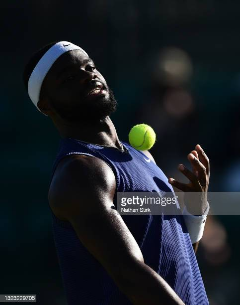Frances Tiafore of United States catches a ball as he plays against Marius Copil of Romania during the men's semi-finals match on day eight of the...