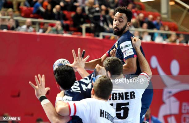 TOPSHOT France's Timothey N Guessan vies with Austria's Tobias Wagner C and Lukas Herburger during the preliminary round group B match of the Men's...