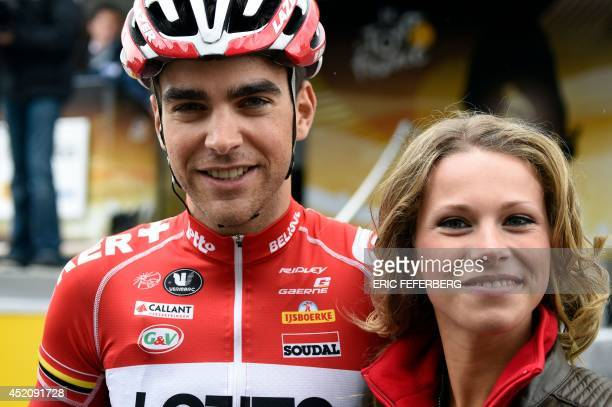 France's Tony Gallopin poses with his girlfriend French cyclist Marion Rousse as he leaves the signature ceremony before the start of the 170 km...
