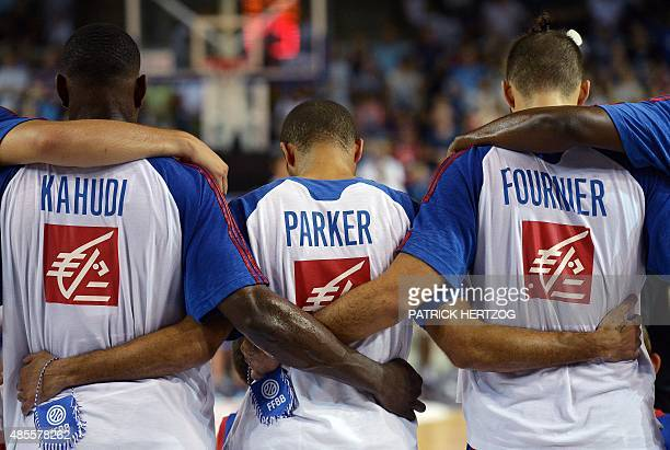 France's Tony Parker and teammates listen to the French national anthem prior to a friendly basketball match between France and Germany on August 28...
