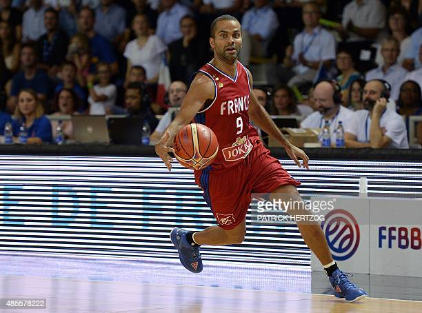 France's Tony Parker dribbles the ball during a friendly basketball match between France and Germany at the Rhenus hall in Strasbourg eastern France...