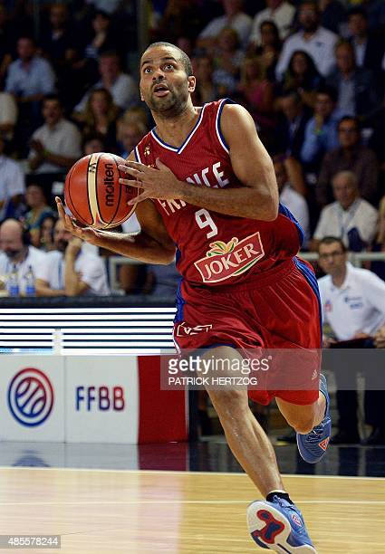 France's Tony Parker runs with the ball during a friendly basketball match between France and Germany at the Rhenus hall in Strasbourg eastern France...
