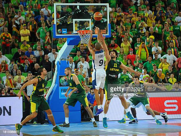 France's Tony Parker shoots the ball past Linas Kleiza of Lithuania during the 2013 EuroBasket Championship final match between France and Lithuania...