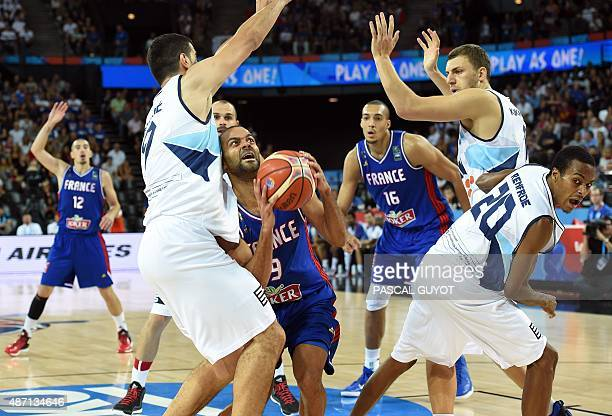 France's Tony Parker vies with Bosnia and Herzegovina's players Edin Bavcic Milan Milosevic Nemenja Gordic and Alex Renfroe during the group A...