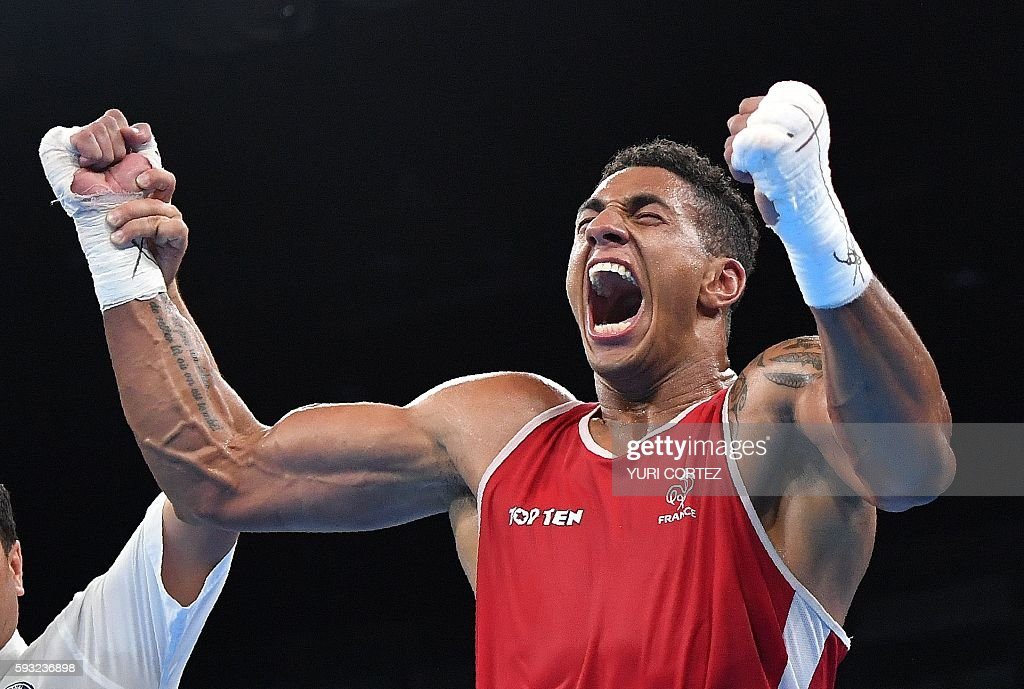 TOPSHOT - France's Tony Victor James Yoka celebrates after winning against Great Britain's Joe Joyce (unseen) during the Men's Super Heavy (+91kg) Final Bout at the Rio 2016 Olympic Games at the Riocentro - Pavilion 6 in Rio de Janeiro on August 21, 2016. / AFP / Yuri CORTEZ