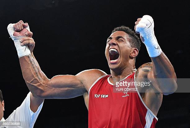 TOPSHOT France's Tony Victor James Yoka celebrates after winning against Great Britain's Joe Joyce during the Men's Super Heavy Final Bout at the Rio...