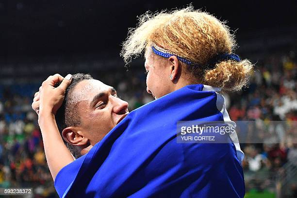 TOPSHOT France's Tony Victor James Yoka is congratulated by his wife French boxer and gold medalist Estelle Mossely after he won against Great...