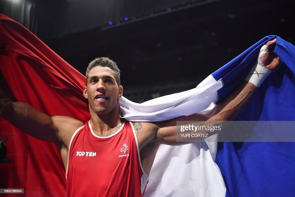 TOPSHOT - France's Tony Victor James Yoka reacts after winning against Great Britain's Joe Joyce during the Men's Super Heavy (+91kg) Final Bout at the Rio 2016 Olympic Games at the Riocentro - Pavilion 6 in Rio de Janeiro on August 21, 2016. France's Tony Victor James Yoka won the match. / AFP / Yuri CORTEZ