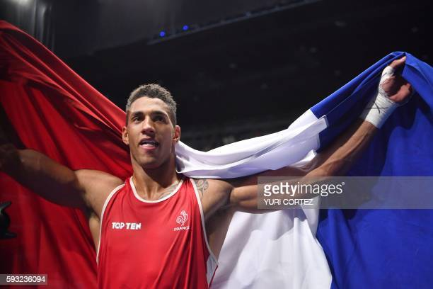 TOPSHOT France's Tony Victor James Yoka reacts after winning against Great Britain's Joe Joyce during the Men's Super Heavy Final Bout at the Rio...