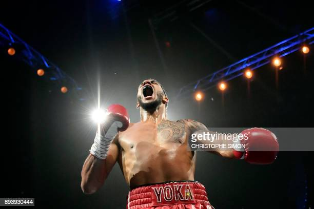 France's Tony Yoka celebrates after winning his Heavy weight boxing bout against Belgium's Ali Baghouz on December 16 2017 in BoulogneBillancourt /...