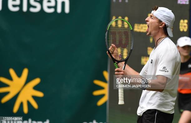France's Ugo Humbert reacts after winning his semi-final match against Felix Auger-Aliassime from Canada at the ATP 500 Halle Open tennis tournament...