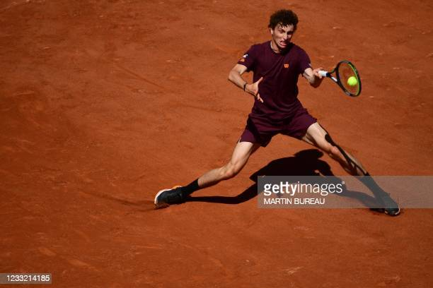 France's Ugo Humbert returns the ball to Lithuania's Ricardas Berankis during their men's singles first round tennis match on Day 3 of The Roland...