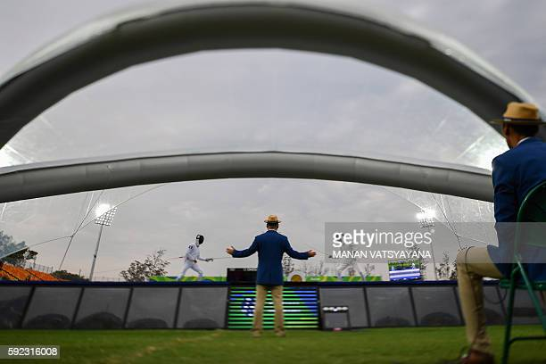 France's Valentin Belaud competes with Italy's Riccardo De Luca in the fencing portion of the men's modern pentathlon event at the Deodoro Stadium...