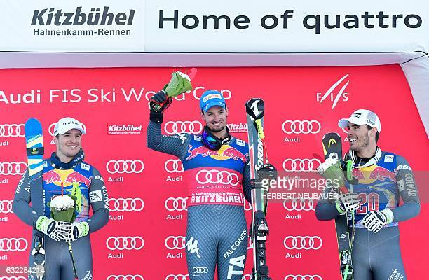 France's Valentin Giraud Moine, second, Italy's winner Dominik Paris and France's Johan Clarey, third, celebrate on the podium of the men's downhill...