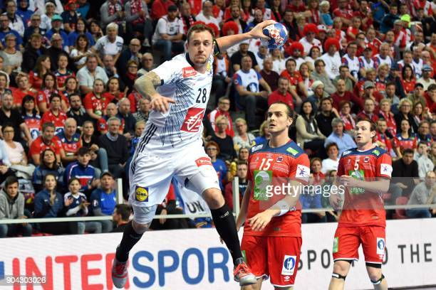 France's Valentin Porte shoots on goal during the preliminary round group B match of the Men's 2018 EHF European Handball Championship between France...