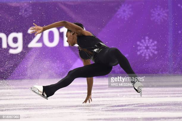 TOPSHOT France's Vanessa James falls as she and partner France's Morgan Cipres compete in the pair skating free skating of the figure skating event...