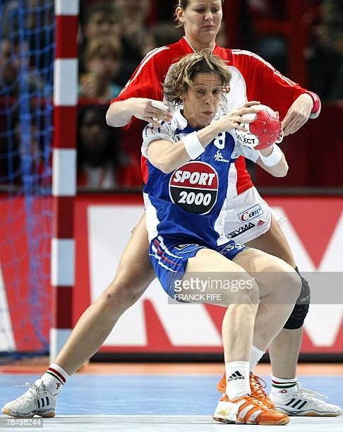 France's Veronique Pecqeux Rolland vies with Hungary's Gabriella Szucs during the women world championship handball place 5 to 8 qualifying match...