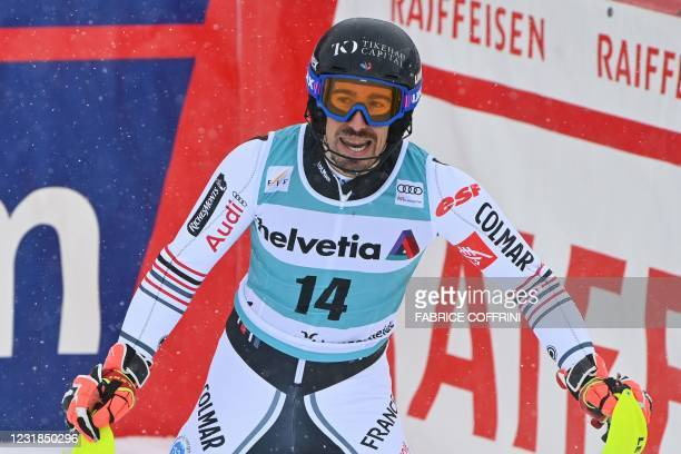France's Victor Muffat-Jeandet reacts in the finishing area after competing in the second run of the Men's Slalom event during the FIS Alpine ski...