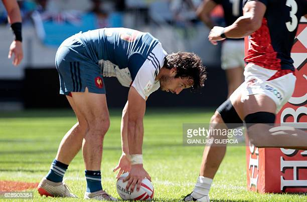 France's Vincent Inigo scores a try during the World Sevens Cape Town leg rugby group match between France and Japan on December 10 2016 in Cape Town...
