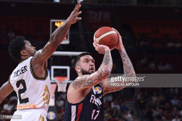 France's Vincent Poirier takes a shot as Jordan's Dar Tucker attemps to block during the Basketball World Cup Group G game between Jordan and France...