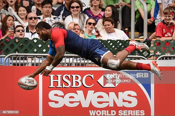 France's Virimi Vakatawa scores a try during a match between France and Canada on the third and final day of the rugby sevens tournament in Hong Kong...