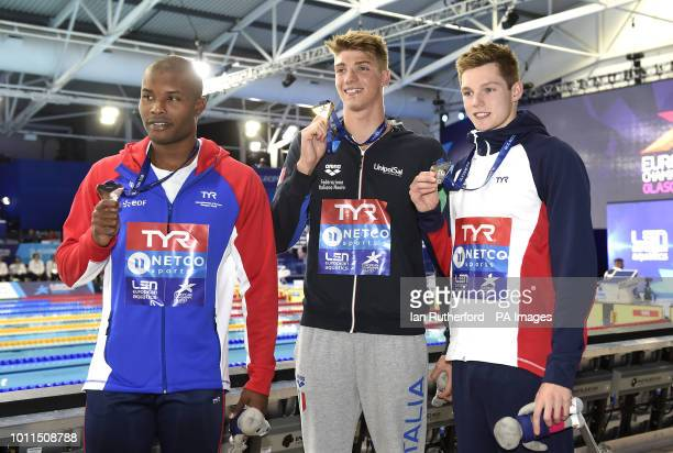 France's Vladislav Grinev Italy's Alessandro Miressi and Great Britain's Scott Duncan with their medals after the Men's 100m Freestyle Final during...