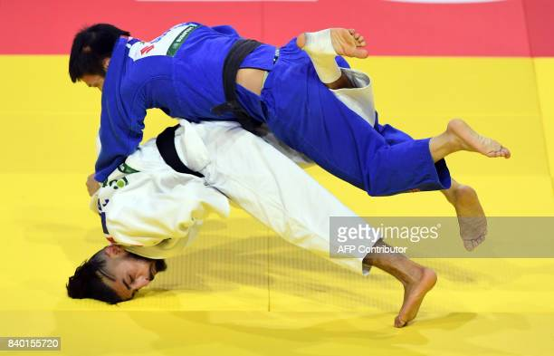 TOPSHOT France's Walide Khyar competes with Mongolia's Boldbaatar Ganbat during their match in the mens 60kg category at the World Judo Championships...