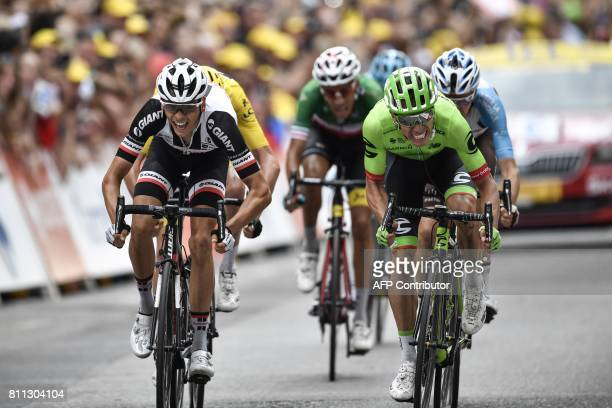 TOPSHOT France's Warren Barguil and Colombia's Rigoberto Uran cross the finish line at the end of the 1815 km ninth stage of the 104th edition of the...