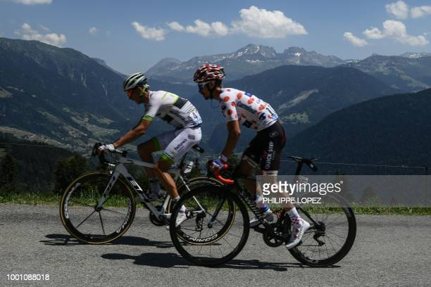 France's Warren Barguil and France's Julian Alaphilippe wearing the best climber's polka dot jersey ride in the ascent of Bisanne during their...