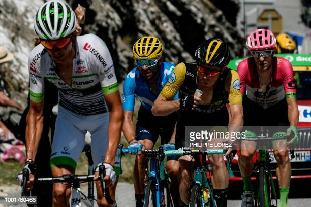 France's Warren Barguil Spain's Alejandro Valverde Netherlands' Robert Gesink and France's Pierre Rolland ride in a counter attack group during the...