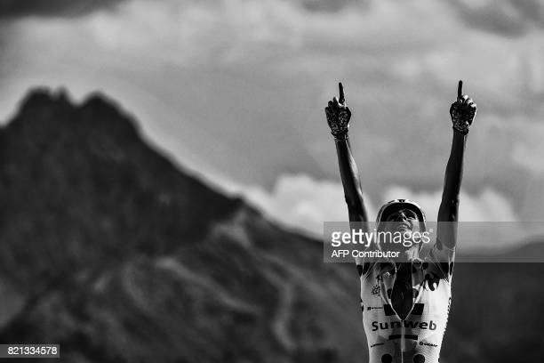 France's Warren Barguil, wearing the best climber's polka dot jersey, celebrates as he crosses the finish line at the end of the 179,5 km eighteenth...