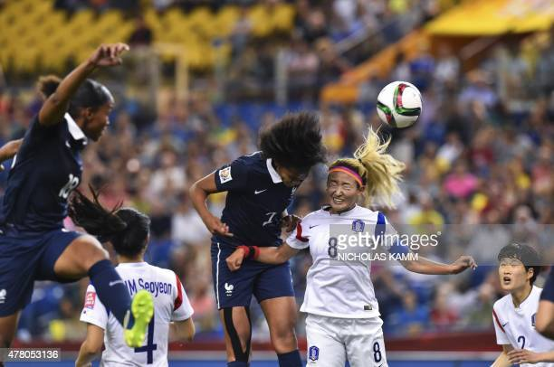 France's Wendie Renard and South Korea's Cho Sonhyun fight for the ball during a 2015 FIFA Women's World Cup round of 16 match at the Olympic Stadium...