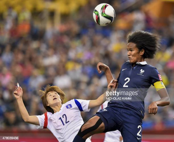 France's Wendie Renard heads the ball past South Korea's Yoo Younga during a 2015 FIFA Women's World Cup round of 16 match at the Olympic Stadium in...