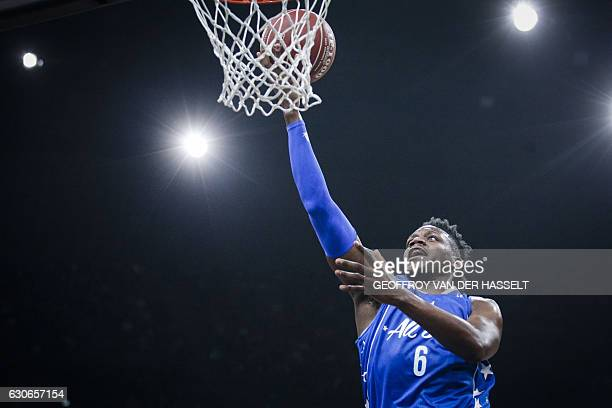 France's Wilfried Yeguete shoots the ball during an All Star Game basketball match of the French Ligue Nationale de Basket between a selection of the...